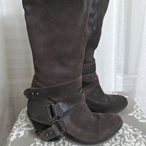 Knee high leather Fergie boots